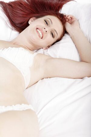 Attractive young woman lying on her bed in her underwear at home Stock Photo - 15441012