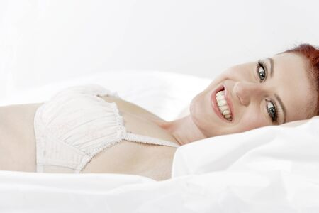 Attractive young woman lying on her bed in her underwear at home Stock Photo - 15440925