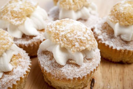 A group of fresh cakes with cream on wooden board Stock Photo - 15572115