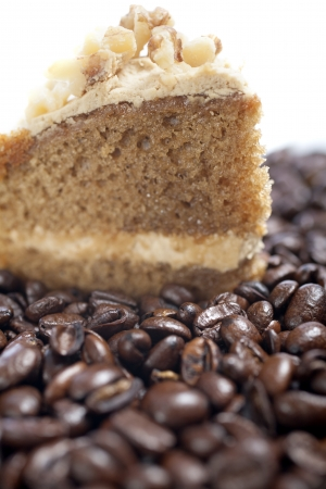 Fresh coffee cake surrounded by dried coffee beans Stock Photo - 15572100