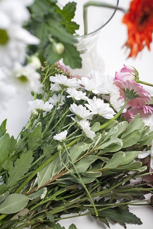 Flower cuttings being prepared to be arranged to make a bouquet. Stock Photo - 15572145