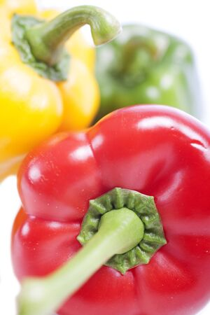 Red Yellow and Green peppers laid out next to each other Stock Photo - 15572113