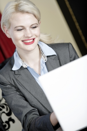 Attractive woman working on her laptop catching up after a long day. Stock Photo - 16217668