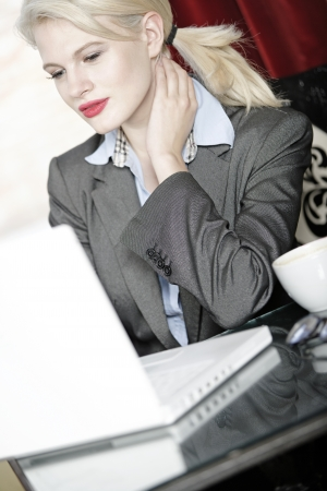 Attractive woman working on her laptop catching up after a long day  Stock Photo - 18000765