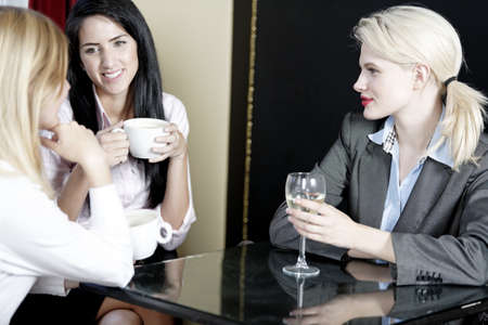 Professional work colleagues meeting up and having a drink. Stock Photo - 16217630