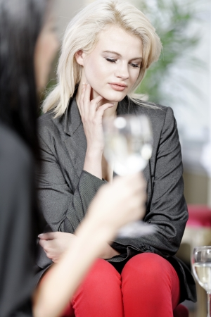 attractive woman waiting for someone at a wine bar. photo