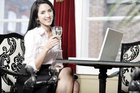 Attractive woman working on her laptop catching up after a long day. photo