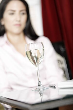 Wine glass in a bar with woman in the background Stock Photo - 16217704