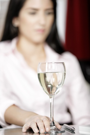 Wine glass in a bar with woman in the background Stock Photo - 16217705