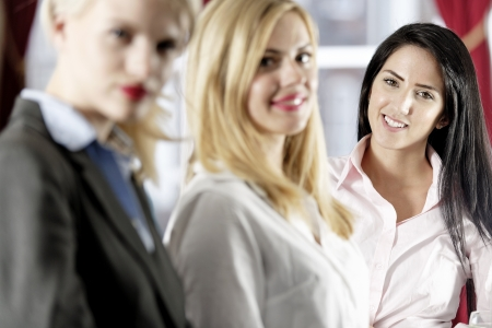 Three attractive female work colleagues together Stock Photo - 18000757