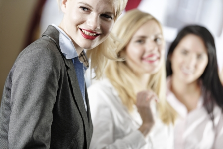 Three attractive female work colleagues together Stock Photo - 18000713