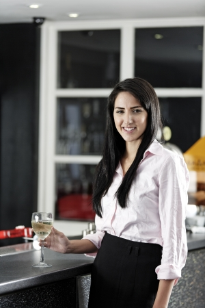Young woman enjoying a glass of wine after work. Stock Photo - 18000716