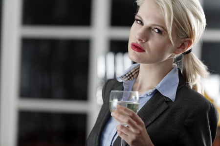 Young woman enjoying a glass of wine after work.