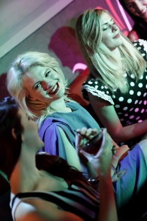 Attractive group of friends laughing and having fun in a nightclub Stock Photo - 18000702