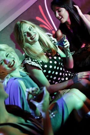 Attractive group of friends laughing and having fun in a nightclub Stock Photo - 18000698