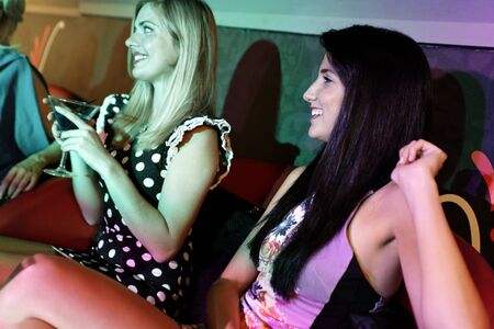 Attractive group of friends laughing and having fun in a nightclub Stock Photo - 18000721