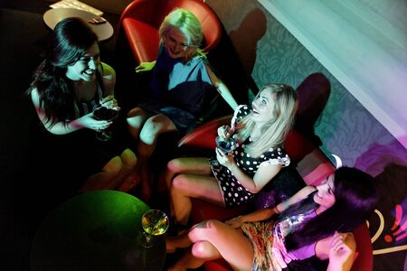 Attractive group of friends laughing and having fun in a nightclub Stock Photo - 18000697