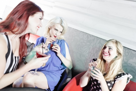 Attractive group of friends laughing and having fun in a nightclub Stock Photo - 18000752