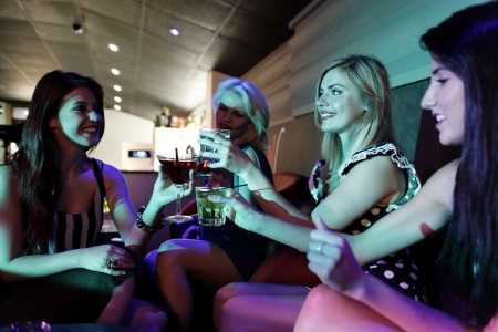 Attractive group of friends laughing and having fun in a nightclub Stock Photo - 18000741