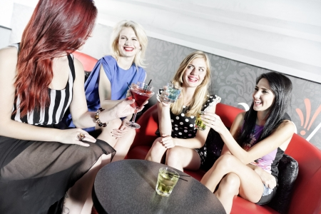 Attractive group of friends laughing and having fun in a nightclub Stock Photo - 18000700
