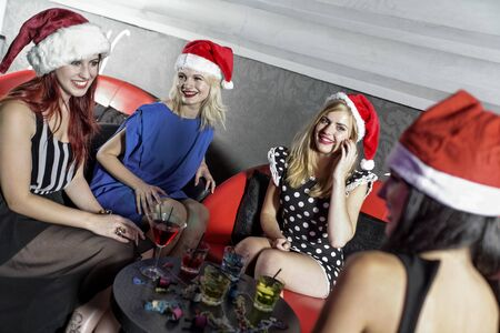Attractive group of friends laughing and having fun at a Christmas party Stock Photo - 18000687