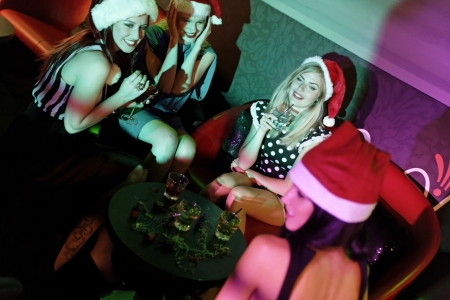 Attractive group of friends laughing and having fun at a Christmas party Stock Photo - 18000711