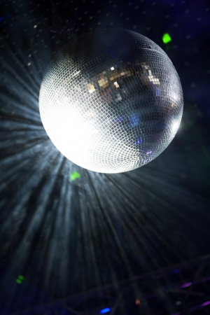 Glitter ball on dance floor with laser lights around