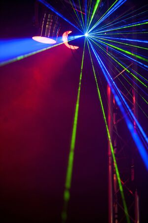 laser lights: Laser lights and smoke on a dance floor in a nightclub.