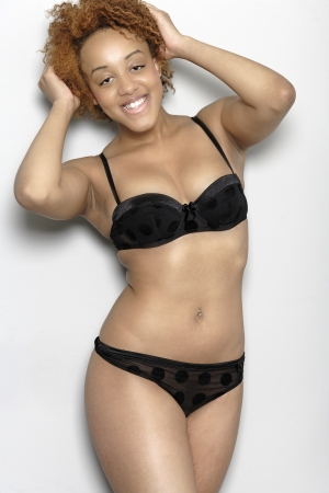 Sexy young black woman in lingerie smiling in lingerie smiling Stock Photo - 18692717