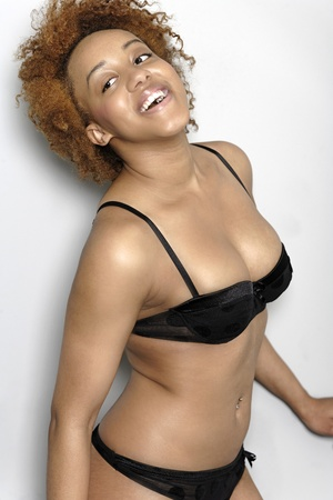 Sexy young black woman in lingerie smiling in lingerie smiling Stock Photo - 18692734