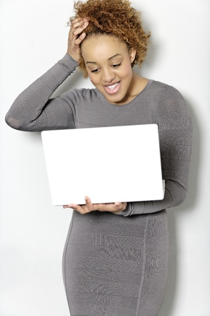 Beautiful young woman holding a laptop computer working Stock Photo - 18692749