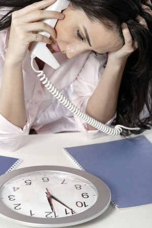 Woman on the phone watching a clock with a deadline approaching Stock Photo - 19070899