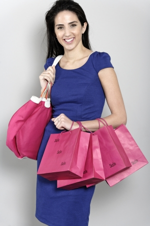 Attractive young woman with lots of shopping bag from a day out shopping. Stock Photo - 19070977