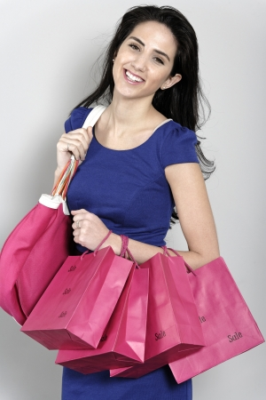 Attractive young woman with lots of shopping bag from a day out shopping. Stock Photo - 19070996