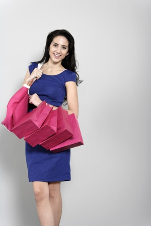 Attractive young woman with lots of shopping bag from a day out shopping. photo