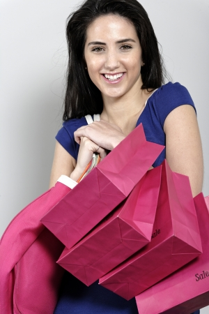 Attractive young woman with lots of shopping bag from a day out shopping. Stock Photo - 19070978