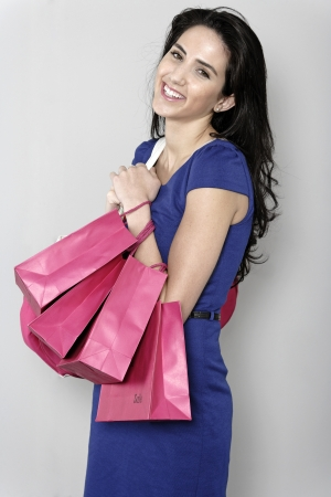Attractive young woman with lots of shopping bag from a day out shopping. Stock Photo - 19070976