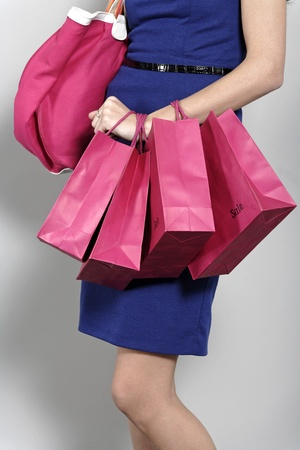 Attractive young woman with lots of shopping bag from a day out shopping. Stock Photo - 19070878