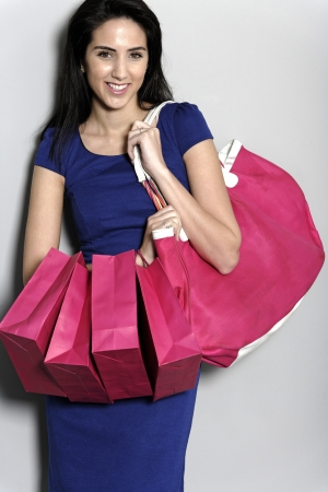 Attractive young woman with lots of shopping bag from a day out shopping. Stock Photo - 19071000