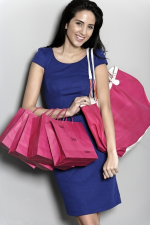 Attractive young woman with lots of shopping bag from a day out shopping. Stock Photo - 19070995