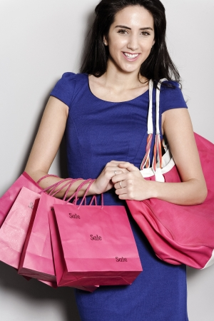 Attractive young woman with lots of shopping bag from a day out shopping. Stock Photo - 19071011