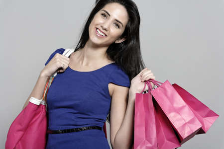 overdraft: Attractive young woman with lots of shopping bag from a day out shopping.