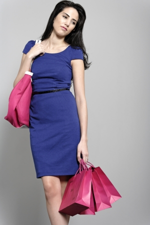 Attractive young woman with lots of shopping bag from a day out shopping. Stock Photo - 19070970
