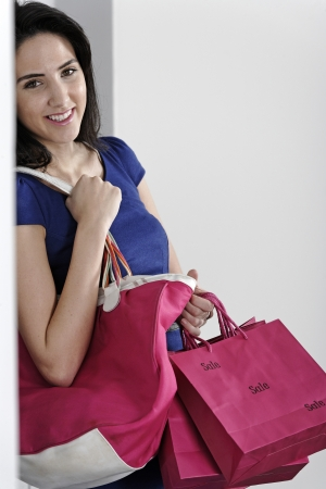 Attractive young woman with lots of shopping bag from a day out shopping. Stock Photo - 19070963