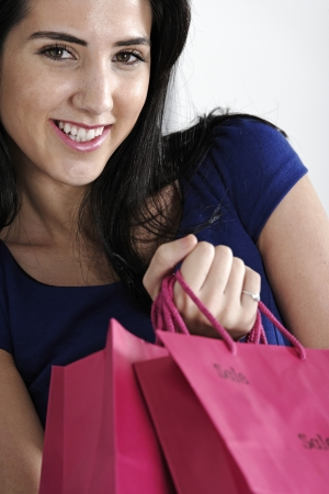 Attractive young woman with lots of shopping bag from a day out shopping. Stock Photo - 19071005