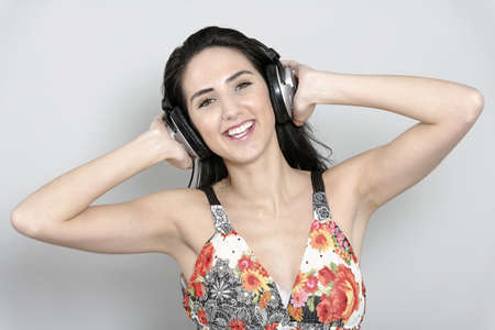 Attractive young woman using headphones to listen to music Stock Photo - 19070967