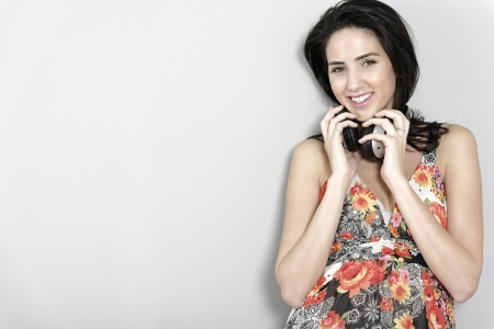 Attractive young woman using headphones to listen to music Stock Photo - 19070966