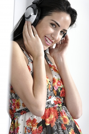 Attractive young woman using headphones to listen to music Stock Photo - 19070992