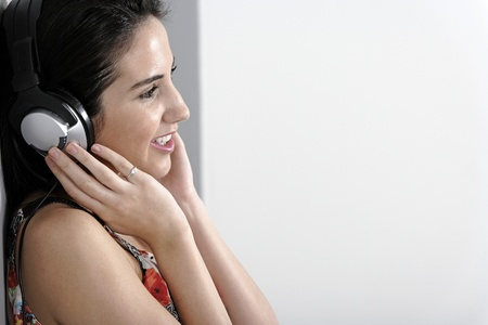 Attractive young woman using headphones to listen to music Stock Photo - 19070884