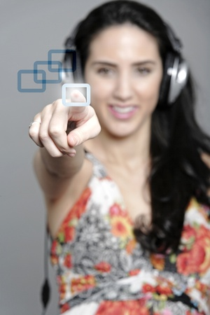 Woman selecting a song to listen to by pressing a concept button Stock Photo - 19070882